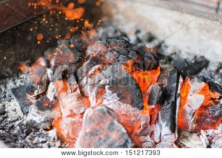 Hot Charcoal Glowing Briquettes. Burning Charcoal Close Up.