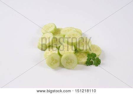 pile of sliced cucumber on white background