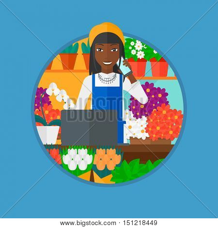 An african-american female florist using telephone and laptop to take orders. A florist standing behind the counter at flower shop. Vector flat design illustration in the circle isolated on background
