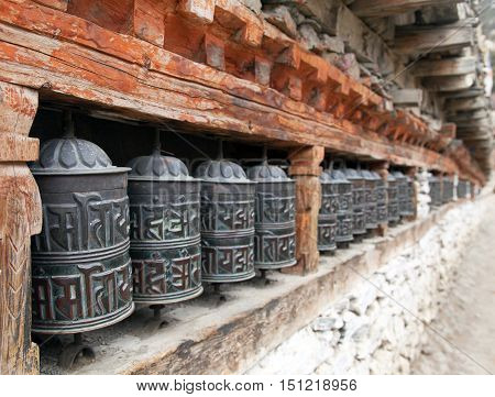 view of Buddhist many prayer wheels - Nepal