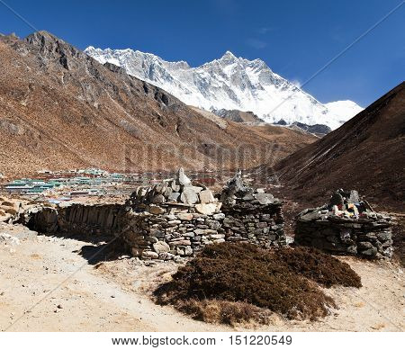 Prayer walls and Dingboche village with mount Lhotse way to Everest base camp Khumbu valley Solukhumbu Sagarmatha national park Nepalese himalayas