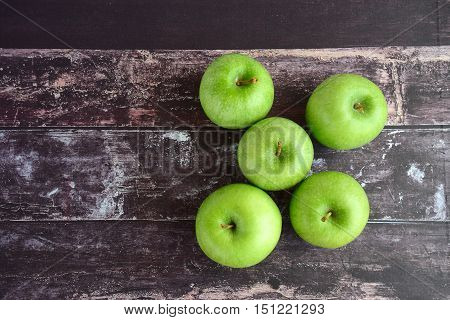Fresh ripe organic Granny Smith apples on wooden background