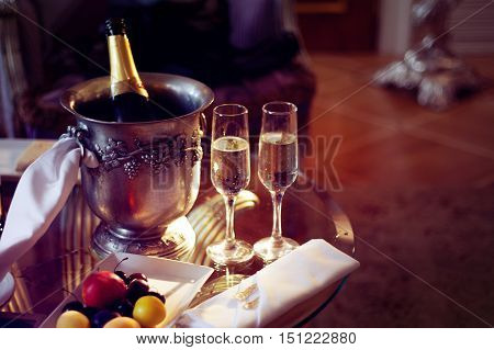 Still life, romantic dinner, two glasses and champagne in the ice bucket