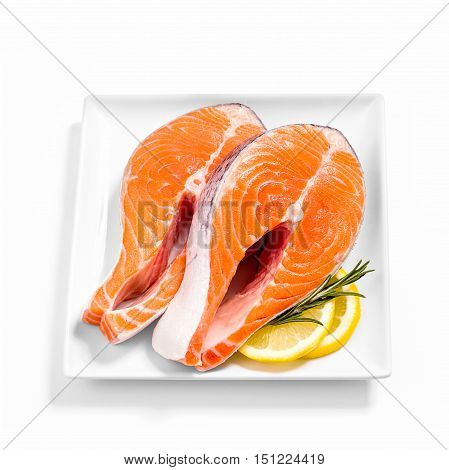 Two delicious raw salmon with lemon slice on plate