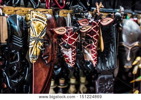 different colorful wooden african masks at market