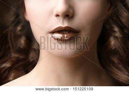 Girl with chocolate lips, closeup