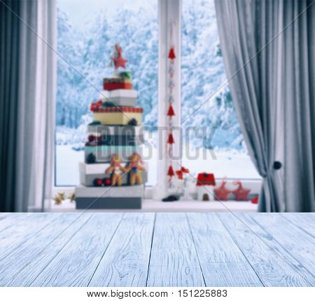 Wooden table on blurred winter window background