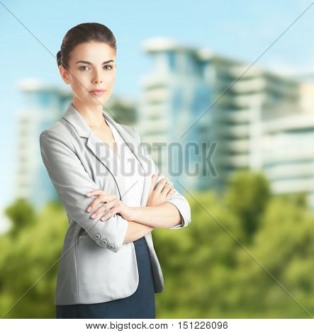 Businesswoman on blurred building background. Lawyer and notary concept.