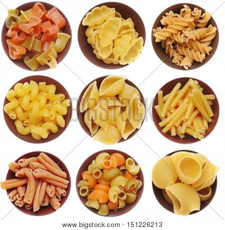 Pasta in wooden bowls isolated on white