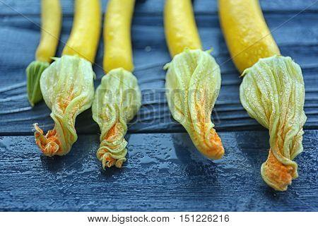 Fresh yellow zucchini on wooden background