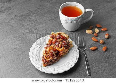 Cup of tea and tasty tart on table