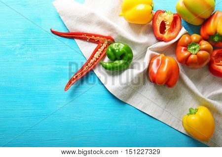 Fresh peppers on blue background