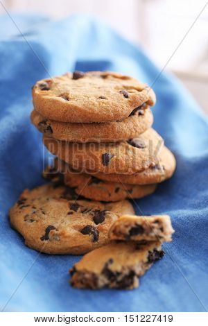 Fresh oat biscuits with chocolate on napkin, closeup