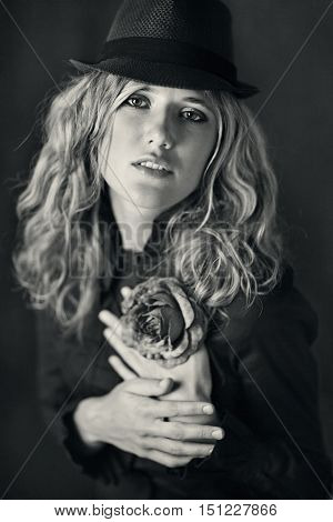black and white retro portrait .sensual portrait of a young girl in a hat .