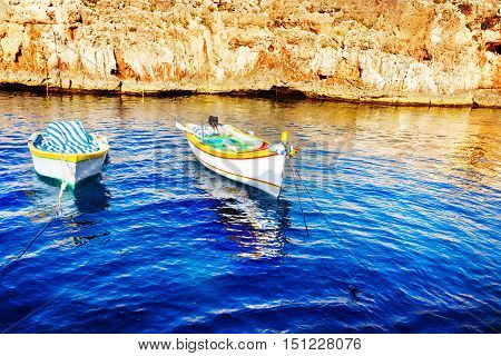 Colored fishing boats Malta In blue water