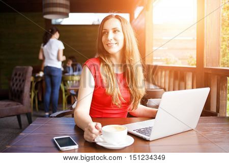 Young Woman Working With Laptop In Cafe