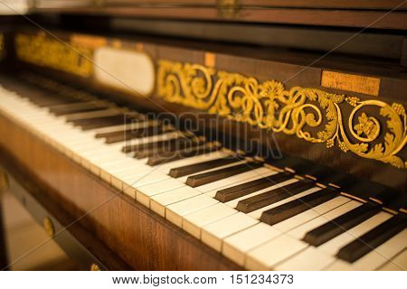 Old piano or harpsichord keyboard decorated with handmade floral ornament