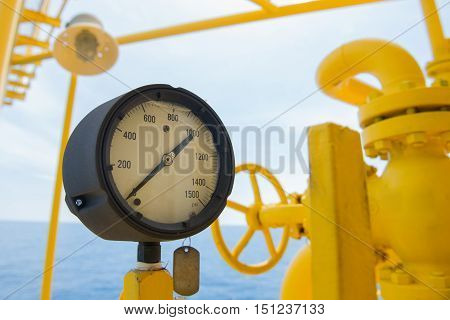 Pressure gauge for monitoring measure pressure in oil and gas process, Oil and gas offshore wellhead remote platform in the gulf or the sea, Energy and petroleum industry.