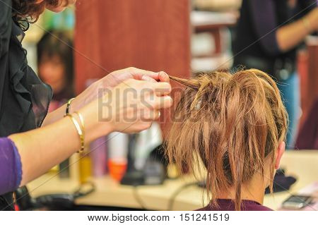 Hairdresser applying hair gel to create a sophisticated hairstyle for a wedding