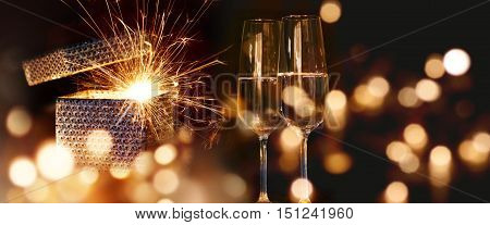 Sparkling New Year wishes with sparkling wine and golden lights