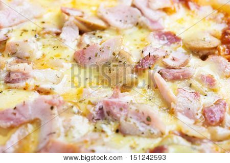 Baked tasty pizza with cheese and ham. International cuisine. Lunch menu. Fast food.
