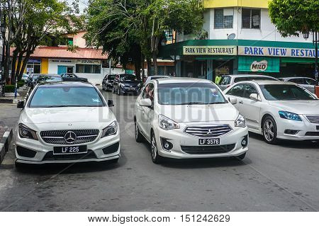 Labuan,Malaysia-Oct 11,2016:Vehicles in Labuan island on 11th Oct 2016.Sabah.Government will be implementing Bank Guarantee on every duty free vehicles Labuan island due to losses of unpaid tax.