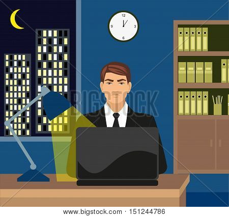 Male working late on her laptop. Surfing the internet, or perhaps working late with . Moonlit city scene can be seen in background through the window.
