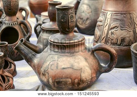 Souvenirs of clay teapots with relief ornament on Sunday clearance sale