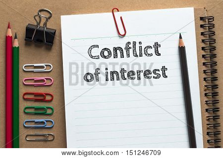 Text Conflict of interest on white paper background business concept