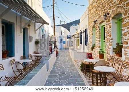 FOLEGANDROS, GREECE - SEPTEMBER 24, 2016: Coffee shop and shops in a street of Folegandros village on September 24.