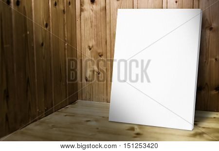 Blank White Poster Leaning At Wooden Wall In Dark Plank Wood Room,mock Up For Adding Your Content