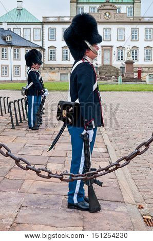 Fredensborg Denmark - August 6 2010: Royal guards changing on Fredensborg palace at August 6 2010 in Fredensborg Denmark - in nasty weather.
