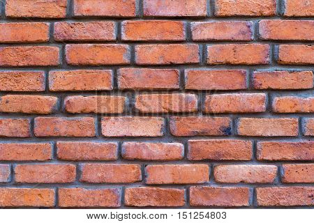 grooved brick texture of red color closeup for background and for wallpaper