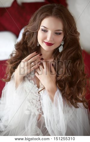 Beautiful Smiling Bride Woman. Wedding Makeup. Attractive Young Girl Model With Long Wavy Hair Weari