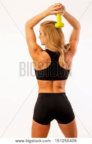 Fitness model posing with dumbell back workout