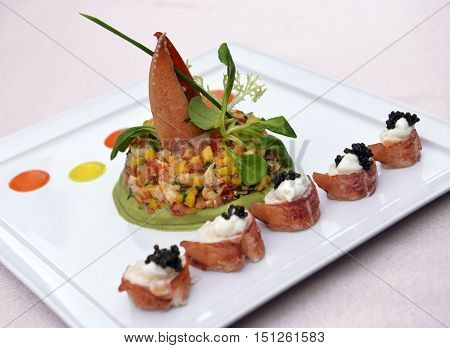 cooked lobster with mango and black caviar