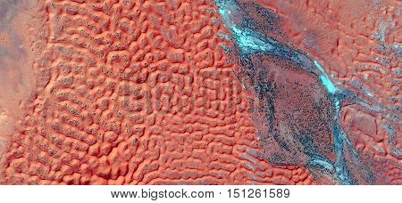 red dunes and blue river fantasy ,abstract landscapes of deserts of Africa,Abstract Naturalism,abstract photography deserts of Africa from the air,abstract surrealism, mirage  Sahara,