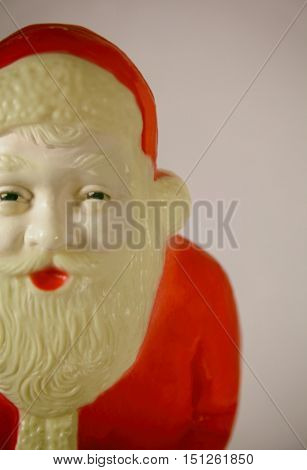 Vintage plastic Santa Claus decoration close up with retro filter applied