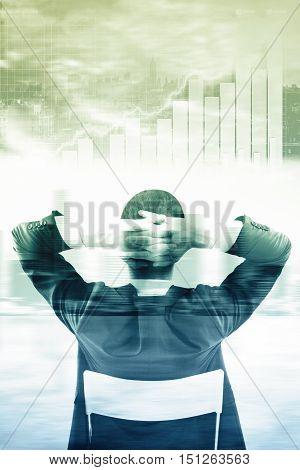 Back view of relaxing businessman looking at abstract city background with business charts. Financial growth concept. Double exposure