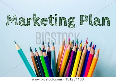 Text Marketing plan on color pencil vintage tone background / Marketing concept