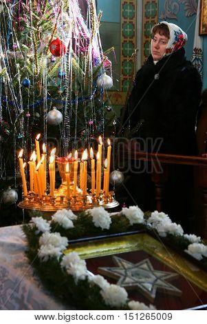 VOYUTYN UKRAINE - 08 JANUARY 2009: Ukrainian parishioners of the Orthodox Church