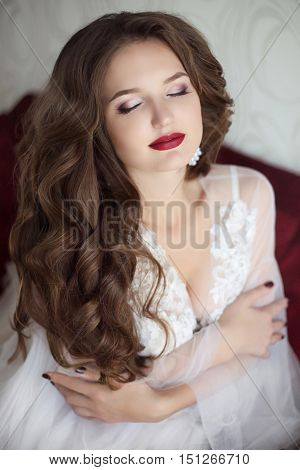 Beautiful Brunette Bride Woman. Wedding Makeup. Attractive Young Girl Model With Long Wavy Hair Wear