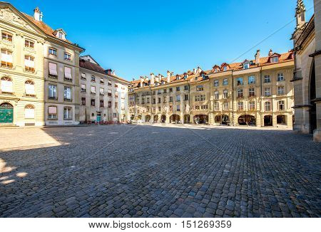 View on the city square with historical buildings near Munster church in the old town of Bern