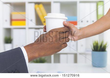 Secretary Giving Coffee To Her Boss