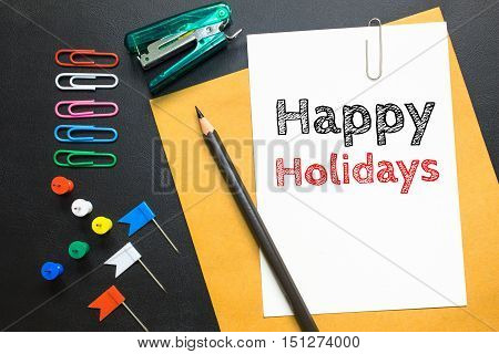 Text Happy holidays on white paper background