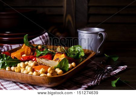 Salad of roasted vegetables and chickpeas. Selective focus.