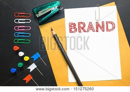 Text BRAND on white paper background / business concpt