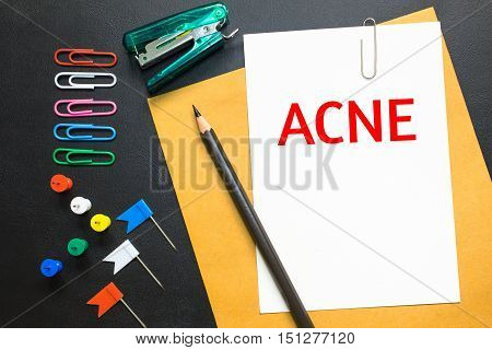 Text ACNE on white paper background / health care concept