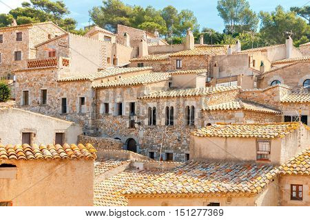 The old huts with tiled roofs in the medieval fortress in Tossa de Mar. Catalonia. Costa Brava.