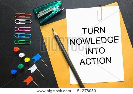 ext Turn knowledge into action on white paper background - business concept